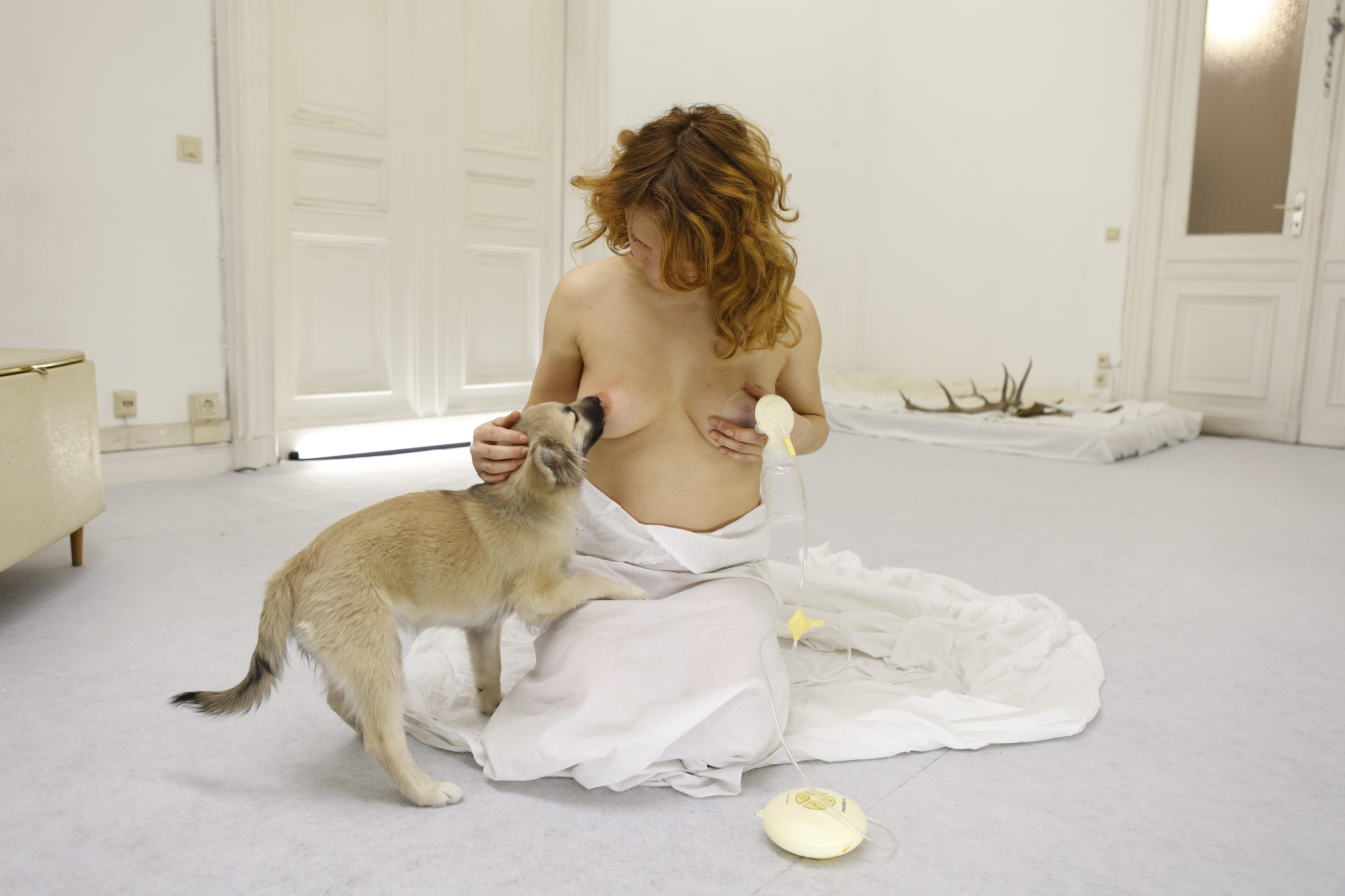 Woman with doglike breasts